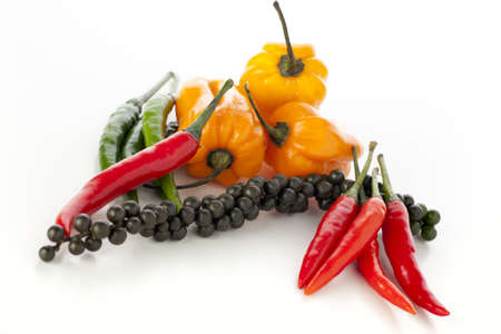 Spicy vegetables: pepper corns, scotch bonnets, red and green chili peppers. photo
