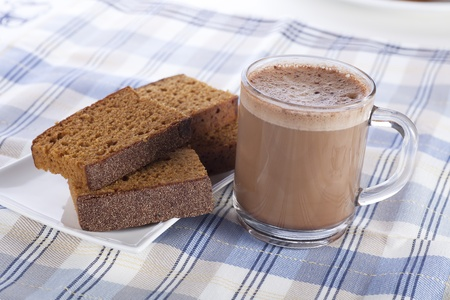 spice cake: Hot chocolate and sweet spice cake on blue and white cloth. Stock Photo