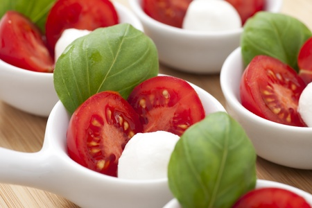 Fresh mozzarella, cherry tomato and basil appetizers.