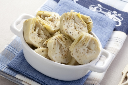 Artichoke hearts covered in herbs served as an appetizer