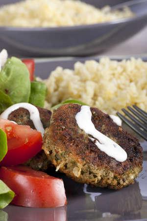 bulgur: Falafel with yogurt sauce with tomatoes, lettuce and bulgur.