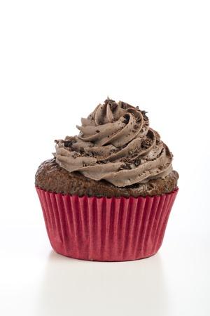 Chocolate cupcake with chocolate icining on white background.