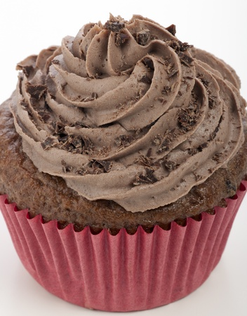 Close-up of chocolate cupcake with chocolate icing and grated chocolate