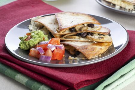 Black bean, mushroom and cheese quesadillas with salsa and guacamole.