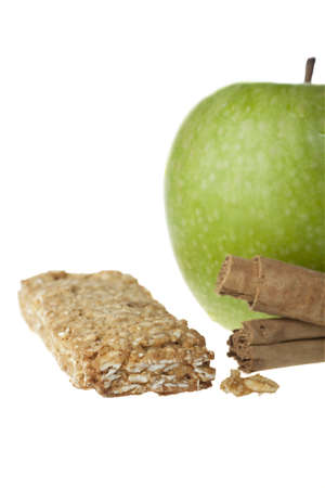 granny smith apple: Granny smith apple, cinnamon sticks and apple cinnamon granola bar.