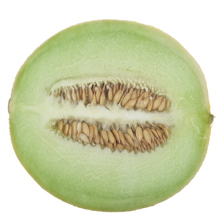 Half a honeydew melon on a white background. Foto de archivo