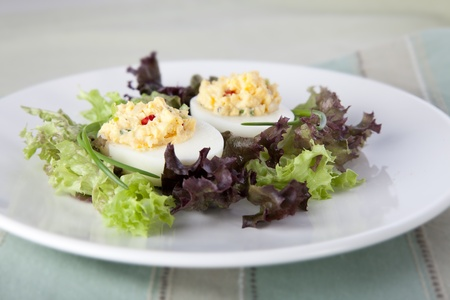 deviled eggs: Gourmet deviled eggs in a bed of lettuce.