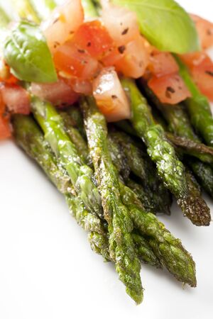 Grilled asparagus topped with a tomato and basil salsa photo