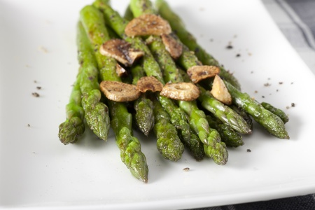 Asparagus appetizer with sauteed garlic sauce.