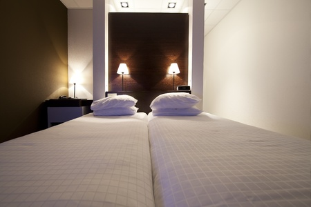 luxury hotel room: Luxury hotel room with emphasis on the bed.