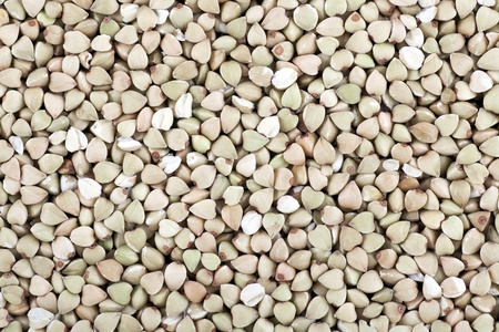 Dried buckwheat seeds filling frame for a food background or texture.