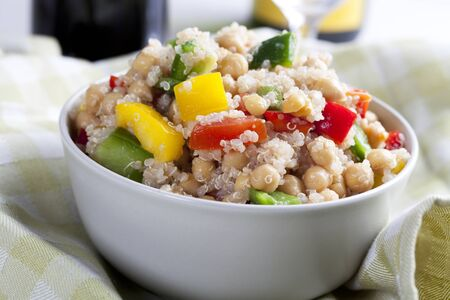 Close up of fresh quinoa salad with bell peppers and chickpeas