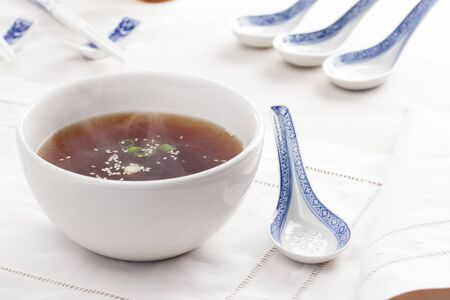 Hot miso soup with traditional spoons Stock Photo - 13884801