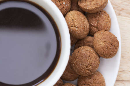 Close up of cup of coffee with kruidenootjes, Dutch spice cookies, around edge   Shot from directly above Stock Photo - 15635926