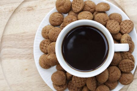 Kruidnootjes surrounding a cup of coffee seen from directly above Stock Photo - 16176615
