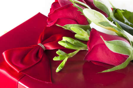 Romantic red gift with red roses  photo