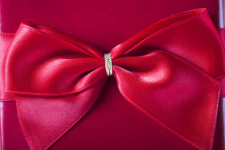 Close-up of red bow on red gift box  photo