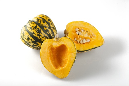 Cut and whole winter squash on white background with shadows  Stock Photo