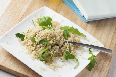 Fresh quinoa salad with herbs and arugula