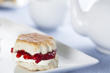 English scones with cream and strawberry jam photo
