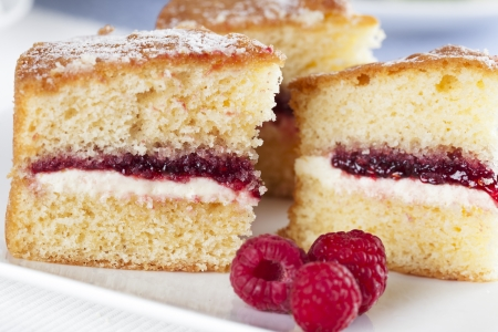 sponge cake: Victoria sponge cake with cream and jam filling, served with raspberries