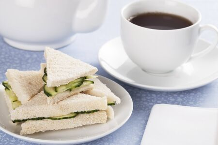 Cucumber sandwiches and cup of tea photo