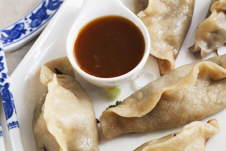 potstickers: Potstickers appetizer with orange soy sauce  Stock Photo