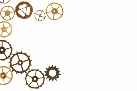Cogs and other watch parts isolated on white background with copy space