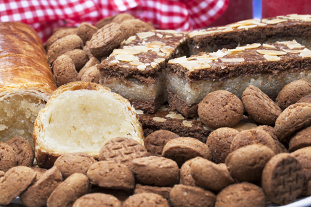 speculaas: Dutch holiday treats: speculaas, kruidnootjes, almond loaf. Stock Photo
