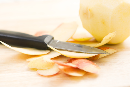 paring: Apple peels with paring knife, shallow depth of field