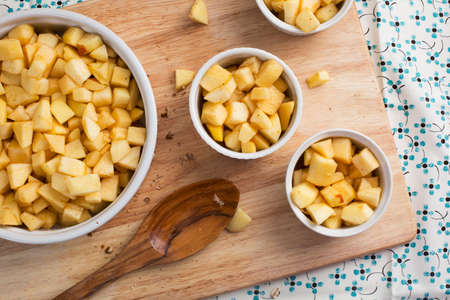 Chopped apples with sugar and spices in baking dishes. photo