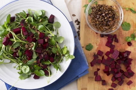 Watercress and beetroot salad with toasted sunflower seeds. photo