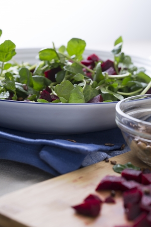 Watercress and beetroot salad with toasted sunflower seeds.