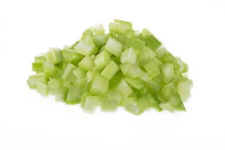 Chopped raw celery isolated on white background