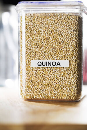 labeled: Quinoa in labeled container on counter  Stock Photo