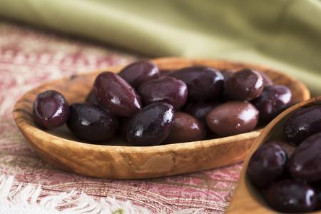 kalamata: Kalamata olives in a small wooden bowl