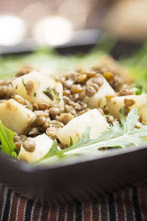 rocket lettuce: Healthy lentil and celeriac salad on rocket lettuce vertical orientation