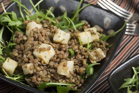 rocket lettuce: Healthy lentil and celeriac salad on rocket lettuce Stock Photo