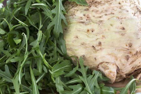 Celeriac and Arugula lettuce ingredients for a healthy salad Imagens