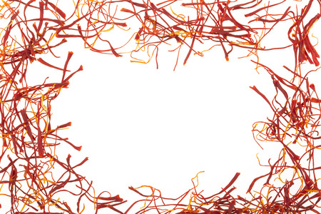 Frame of saffron isolated on white background Foto de archivo