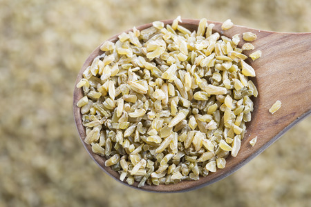 Healthy Freekeh in wooden spoon. Foto de archivo