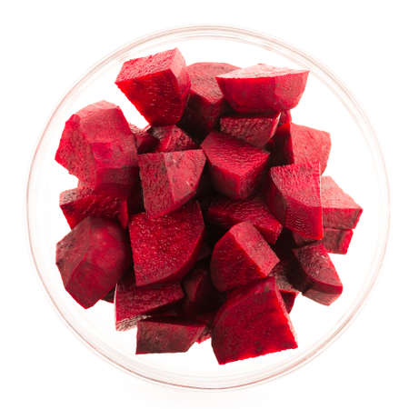 Beetroot wedges in glass bowl isolated on white.