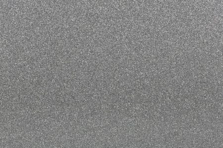Shiny granular background texture in gray, easy to colorize.