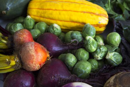 Fresh squash, brussels sprouts, and beets for a delicious winter soup.