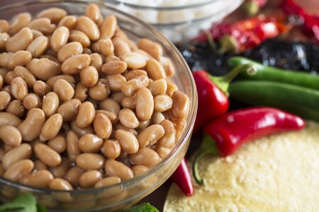 pinto beans: Cooked pinto beans and other ingredients for Mexican cooking.