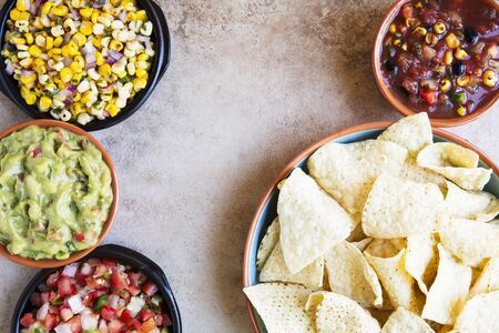 gallo: Tortilla chips served with guacamole, salsa, and pico de gallo with copy space, view from above.