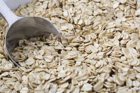 Healthy raw oats with scoop