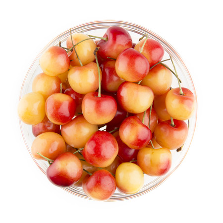 Rainier Cherries in a bowl, isolated on white and viewed from above. Stock Photo