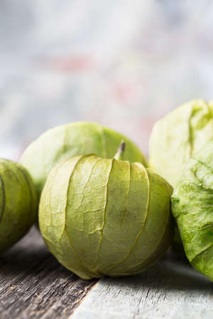 husk tomato: Close up of tomatillos with copy space, vertical orientation.