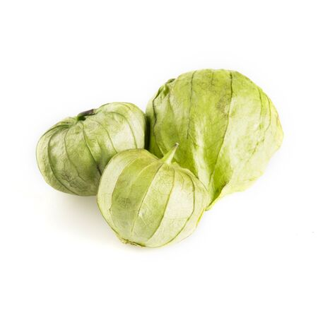 Three tomatillos isolated on a white background.